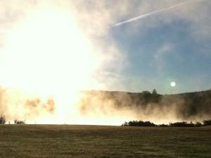 Sun shrouded in lake mist shortly after sunrise.