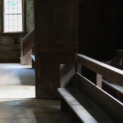 quaker meeting housing benches in sunlight